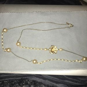 Long gold chain and faux pearl necklace